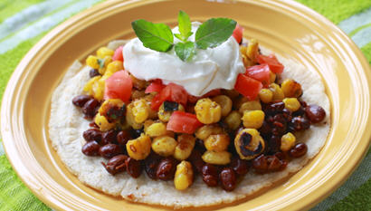Mexican Style Grilled Corn with Black Beans and a Citrus Cream Sauce